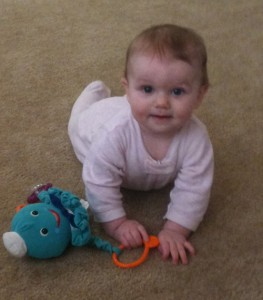 Eloise almost crawling, but mostly just chewing on her toys.