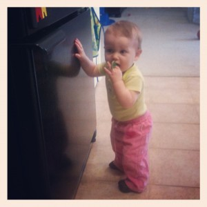 Eloise standing at the fridge eating the magnetic letters. Totally safe.